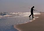 CAPE HATTERAS NATIONAL SEASHORE, NORTH CAROLINA. USA. Surf fisherman calls it a morning. Outer Banks.
