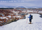 BRYCE CANYON NATIONAL PARK, UTAH. USA. Hiker on snowshoes on record snowpack at Bryce Point. March.