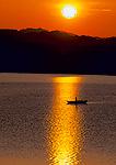 LAKE MEAD NATIONAL RECREATION AREA, NEVADA. USA. Fishermen on Lake Mead at sunrise.