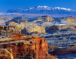 CAPITOL REEF NATIONAL PARK, UTAH. USA. Snow on sandstone domes of Capitol Reef. Henry Mountains in the distance. View from East Rim. Colorado Plateau.