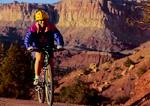 CAPITOL REEF NATIONAL PARK, UTAH. USA. Mountain biker on dirt road.