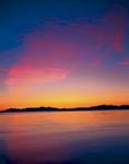WILLARD BAY STATE PARK, UTAH. USA. Cirrus undulatus cloud above Willard Bay at dusk. Wasatch Front. Great Basin. Promontory Mountain in distance.