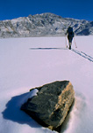 DEATH VALLEY NATIONAL PARK, CALIFORNIA. USA. Backcountry skier on the Racetrack Playa after rare winter snow storm.