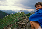 DENALI NATIONAL PARK & PRESERVE, ALASKA. USA. Backpacker & Dall sheep. Sable Mountain.