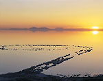UTAH. USA. Spiral Jetty is barely visible above water of Great Salt Lake near Rozelle Point. Earthwork created by Robert Smithson in 1970. Spiral is 1500 feet long. Photo made November 2002.