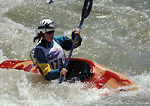 UTAH. USA. Woman kayaker competing in whitewater rodeo on Weber River. Weber River Kayak Festival.