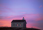 TALLGRASS PRAIRIE NATIONAL PRESERVE, KANSAS. USA. Historic Lower Fox Creek Schoolhouse at sunset. Flint Hills.
