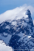 GRAND TETON NATIONAL PARK, WYOMING. USA. Clouds blow over summit of Grand Teton in high winds. Teton Range.