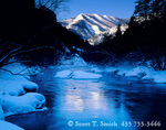 UTAH. USA. Light of sunrise on Mount Beirdneau in winter above icy Logan River. Logan Canyon. Bear River Range. Wasatch-Cache National Forest.