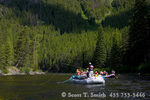 FRANK CHURCH RIVER OF NO RETURN WILDERNESS, IDAHO. USA. Rafts on Middle Fork Salmon River below forested slopes. Challis National Forest.