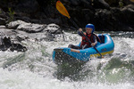 FRANK CHURCH RIVER OF NO RETURN WILDERNESS, IDAHO. USA. 11-year-old boy in inflatable kayak at Tappan Falls. 1 of 7. Middle Fork Salmon River. Challis National Forest.