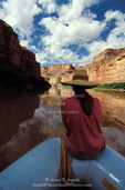 CANYONLANDS NATIONAL PARK, UTAH. USA. Passenger on raft on Green River in Stillwater Canyon.