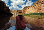 CANYONLANDS NATIONAL PARK, UTAH. USA. Woman passenger on raft on Green River in Stillwater Canyon.