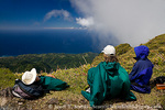 MARTINIQUE. French Antilles. West Indies. Hikers take a break in high wind near summit of Mt. Pelée. Caribbean Sea in distance.