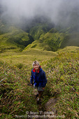 MARTINIQUE. French Antilles. West Indies. Woman hiker on steep trail above rugged gorges carved into flanks of Mt. Pelée.