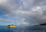 MARTINIQUE. French Antilles. West Indies. Rainbow over sailboat anchored in harbor at St. Pierre.