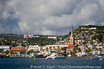MARTINIQUE. French Antilles. West Indies. City of Fort-de-France below cumulus clouds. Steeple of St. Louis Cathedral is visible.