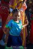 MARTINIQUE. French Antilles. West Indies. Fort-de-France. Young girl with her mother joins procession during Carnival Parade.