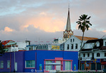 MARTINIQUE. French Antilles. West Indies. Fort-de-France. Steeple of St. Louis Cathedral rises above waterfront buildings at dawn.