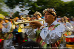 MARTINIQUE. French Antilles. West Indies. Fort-de-France. Man plays trumpet in parade during Carnival.