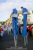 """MARTINIQUE. French Antilles. West Indies. Fort-de-France. """"Moko Zombie"""", marchers on stilts in parade during Carnival."""