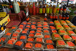 MARTINIQUE. French Antilles. West Indies. Fort-de-France. Spices, syrups, & sauces for sale at market downtown.