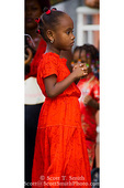 """MARTINIQUE. French Antilles. West Indies. Fort-de-France. Young girl parade spectator on """"Red Devil Day"""" (everybody wears red) during Carnival."""
