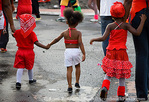 "MARTINIQUE. French Antilles. West Indies. Fort-de-France. Young parade spectators on ""Red Devil Day"" (everybody wears red) during Carnival."
