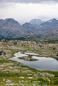 BRIDGER WILDERNESS, WYOMING. USA. Lake in glacially-carved Bald Mountain Basin in Wind River Range. Bridger-Teton National Forest. Fremont Peak (13,745 feet) is large dome in distance. Along Continental Divide National Scenic Trail (locally called Fremont Trail).