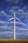 OREGON. USA. Wind turbine below cumulus clouds. Wind farm near Condon. Turbines owned by Bonneville Power Admin. 197 foot towers; 155 foot diameter rotors. 83 turbines produce 50 MW peak