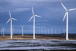 OREGON. USA. Wind turbines below stratus clouds. Wind farm near Condon. Turbines owned by Bonneville Power Admin. 197 foot towers; 155 foot diameter rotors. 83 turbines produce 50 MW peak