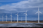 OREGON. USA. Wind turbines below stratus clouds. Wind farm near Condon. Turbines owned by Bonneville Power Admin. 197 foot towers; 155 foot diameter rotors. 83 turbines produce 50 MW peak