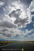 """NEVADA. USA. Cumulus clouds over US Highway 50. """"The Loneliest Road in America"""". Great Basin."""