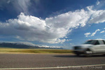 "NEVADA. USA. Cumulus clouds above Reese River Valley & US Highway 50. ""The Loneliest Road in America"". Great Basin."