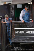ELY, NEVADA. USA. Engineer & fireman in cab of steam locomotive 93. Put into service in 1909 by Nevada Northern Railroad to haul ore, 93 is now part of Nevada Northern Railway Museum. A working locomotive, it hauls visitors along route to Ruth Mine.