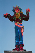 "WENDOVER, NEVADA. USA. ""Wendover Will"" the cowboy welcomes you to the State Line Casino at dusk on the Utah/Nevada state line."