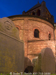 CHARLESTON, SOUTH CAROLINA. USA. Circular Congregational Church. Re-built c. 1892. Headstones & church lit at dusk.