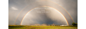 UTAH. USA. Double rainbow over Cache Valley at sunset. Cumulonimbus cloud.