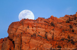 ZION NATIONAL PARK, UTAH. USA. Moonrise over cliffs of Zion Canyon.**Real moon---no double exposure or digital manipulation**