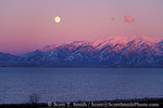 UTAH. USA. Full moon rising at sunset above Wasatch Mountains & Great Salt Lake in winter. View from Antelope Island. Antelope Island State Park. Wasatch Front.
