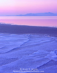 UTAH. USA. Brackish water floating on the much saltier water of Great Salt Lake freezes in plates & slabs during period of sub-zero (F) winter weather. Bear River Bay at dusk. Great Basin.