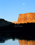 UTAH. USA. Moon & cliffs at sunrise above Green River. Mineral Bottom. Colorado Plateau.