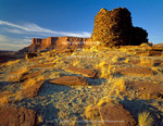 CANYONLANDS NATIONAL PARK, UTAH. USA. Sandstone slabs & pre-historic Anasazi (Ancestral Puebloan) tower. Fort Bottom along Green River.
