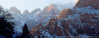 ZION NATIONAL PARK, UTAH. USA. Mist blows around Towers of the Virgin after heavy snow storm.