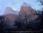 ZION NATIONAL PARK, UTAH. USA. Stratus clouds of winter storm at dawn. Court of the Patriarchs. Zion Canyon.
