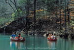 BUFFALO NATIONAL RIVER, ARKANSAS. USA. Family canoeing the Buffalo River in early spring. Ponca Wllderness.