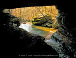 BUFFALO NATIONAL RIVER, ARKANSAS. USA. Clark Creek passes under natural bridge in Lost Valley.