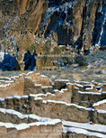BANDELIER NATIONAL MONUMENT, NEW MEXICO. USA. New snow on broken walls of Tyuoni ruin. Ancestral Puebloan structures in Frijoles Canyon below cliffs of volcanic tuff.