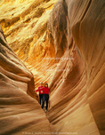 UTAH. USA. Mother & daughter hike through narrows of Little Wildhorse Canyon. San Rafael Swell. Proposed San Rafael Swell BLM Wilderness. Colorado Plateau.