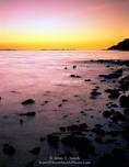 ANTELOPE ISLAND STATE PARK, UTAH. USA. Great Salt Lake & west shore of Antelope Island at dusk. Great Basin.